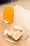 Orange juice and Wafer on the wooden table Royalty Free Stock Photo