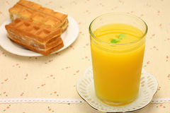 Orange juice and waffle Royalty Free Stock Photography