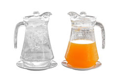 Orange juice and water in pitcher on plate Royalty Free Stock Photography