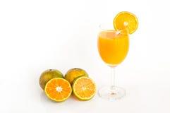 Orange juice on white background. Orange juice and slices in glass on white background royalty free stock photos