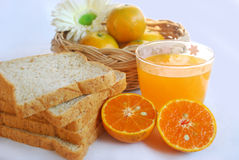 Orange juice and whole wheat bread Stock Photo