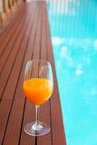 orange juice in wine glass on edge  the blue sky pool in party l Stock Photo