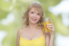 Orange juice woman Stock Images