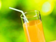 Orange juice on the wood table Stock Photography