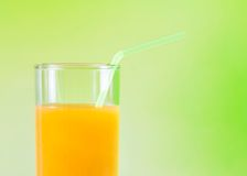 Orange juice on the wood table nutrition concept with space for text. Orange juice on the wood table on green background nutrition concept with space for text stock photo