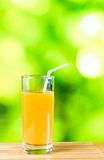 Orange juice on the wood table Stock Images