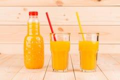 Orange juice. On wooden background. Whole background Royalty Free Stock Photography