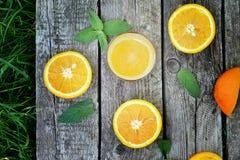 Orange juice. On the wooden backgrownd Stock Image