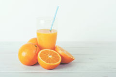 Orange juice. On a wooden table Royalty Free Stock Images