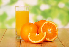 Orange juice on a wooden table Stock Photo