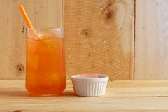 Orange juice on wooden table stock photography