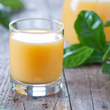 Orange juice. On the wooden table, square image Royalty Free Stock Image