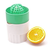 Orange juicer. With an orange next to it Royalty Free Stock Image