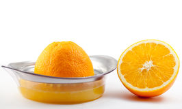 Orange with juicer. Stock Photos