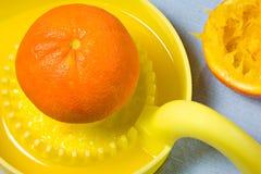 Orange on juicer. For fresh drink Stock Image
