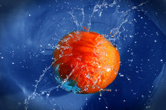 Orange jumping into water. An orange is jumping into water royalty free stock photos