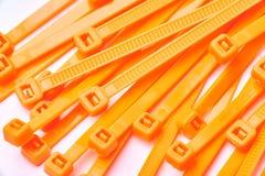 Orange kabelkontakter Kommersiellt foto på vit bakgrund Fotografering för Bildbyråer