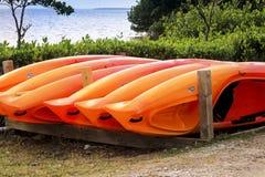 Orange kajaker Fotografering för Bildbyråer