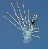 Orange Kampfflugzeug Lizenzfreie Stockfotografie