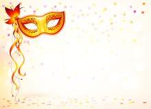 Orange karnevalmaskering på rosa bokehljus Royaltyfri Foto