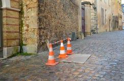 Orange Kegel auf Straße Stockfotografie