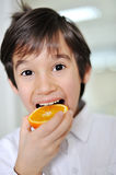 Orange and kid Royalty Free Stock Photography
