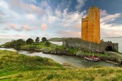 Orange Kilcoe castle. Kilcoe castle on the coast of Co. Cork, Ireland Stock Photography