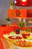 Orange kitchen. Orange color kitchen interior with food royalty free stock images