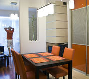 Orange kitchen and man