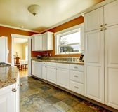 Orange kitchen room with white cabinets Royalty Free Stock Photo
