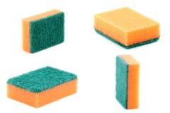 Orange kitchen sponge. Isolated on a white background royalty free stock photography