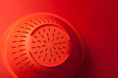 Orange kitchen strainer Royalty Free Stock Photography