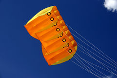 Orange Kite. Large orange kite against the blue sky Royalty Free Stock Images