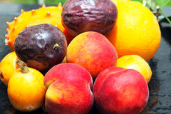 Orange, kiwano, loquat, peach and passionfruit. Exotic fruits: orange, kiwano, loquat, peach and passionfruit Royalty Free Stock Photography