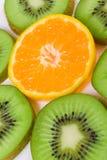 Orange and kiwi. Background of sliced kiwi and orange Royalty Free Stock Image