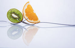 Orange and kiwi fruit composition Stock Photos