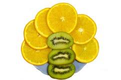 Orange and kiwi fruit. Sliced orange and kiwi slices on a platter Royalty Free Stock Images