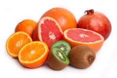 Orange,kiwi,grapefruit and pomegranate Royalty Free Stock Image