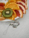Orange kiwi and the hearts Royalty Free Stock Images