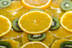Orange and kiwi slices Stock Photos