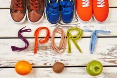 Orange, kiwi and sport footwear. Royalty Free Stock Image