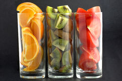 Orange & kiwi & tomato. In the glases Stock Photos