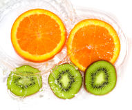 Orange and kiwi in water white Stock Image