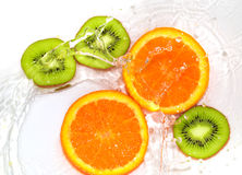 Orange and kiwi in water white Stock Images