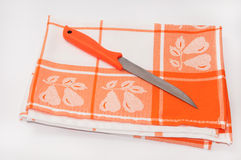 Orange knife on the orange tablecloth Stock Image