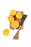 Orange knife on wooden desk isolated. On white Royalty Free Stock Photography