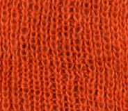 Orange knitted scarf texture Stock Images