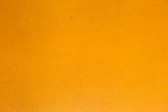 Orange konstläder Arkivfoto