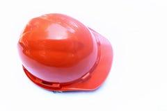 Orange konstruktionssäkerhetshjälm Arkivfoto