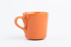 1 orange kopp Fotografering för Bildbyråer